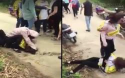 Nữ sinh đánh nhau đập đầu xuống đường, dẫm lên bụng trong tiếng hò reo cổ vũ