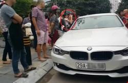 Ông bố Hà Nội đập vỡ kính xe BMW cứu con gái bị mắc kẹt