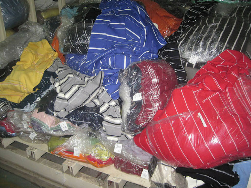 Vải may áo thun cá sấu tại kho xưởng may đồng phục áo thun cá sấu