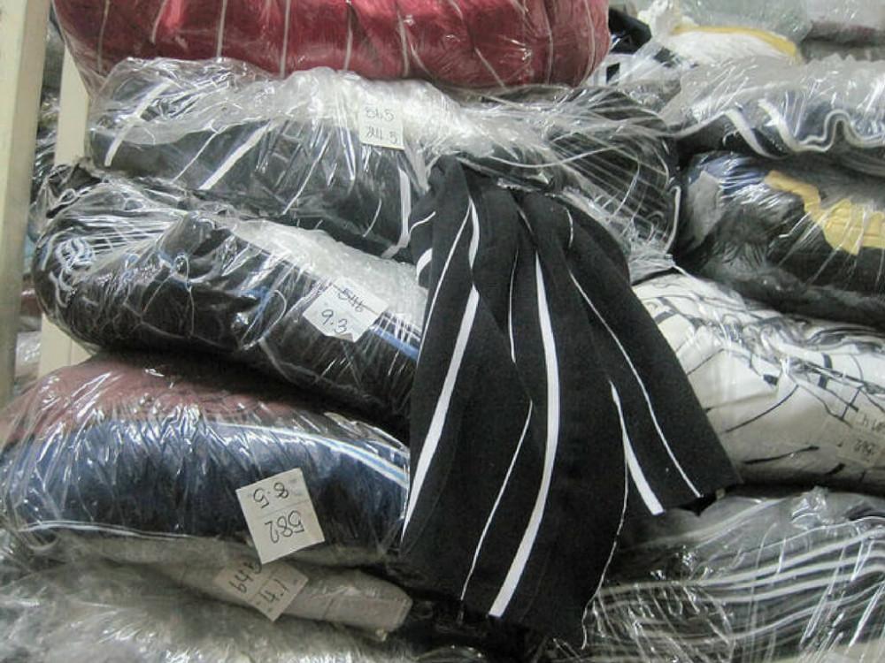 Các chất liệu vải áo thun cá sấu tại kho xưởng may đồng phục áo thun cá sấu