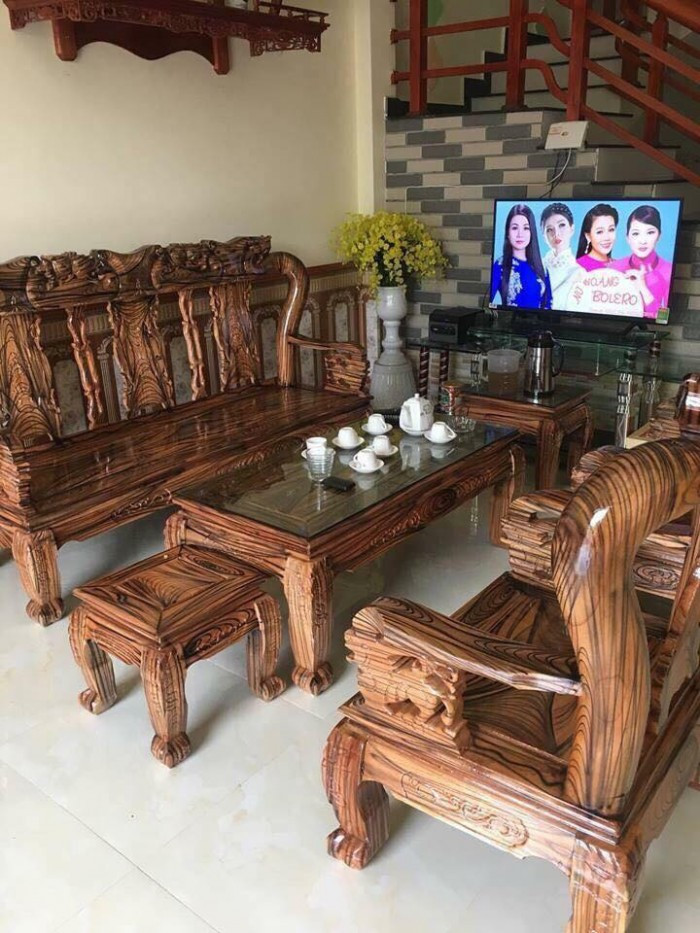 Mẫu bàn ghế gỗ phòng khách Minh Quốc tràm PU giả mun