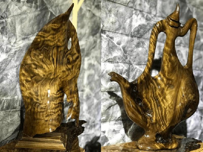 Bình cắm lông công được chế tác từ gỗ thủy tùng việt vân chun quý hiếm 100% tự nhiên kích thước 60x30cm giá 20,000,000 VNĐ